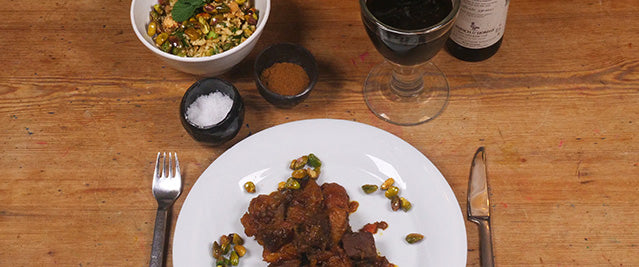 Image of spicy venison dish and a bowl of cauliflower couscous on a set table.