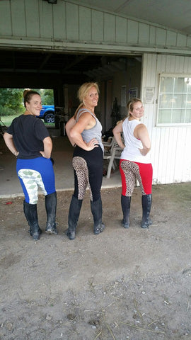 Three ladies rock our signature blue argyle, black with leopard print and red with leopard print full-seat breeches at their barn