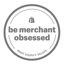 "A circular logo with a Shopify shopping bag above the words ""Be Merchant Obsessed. What Shopify Values"""