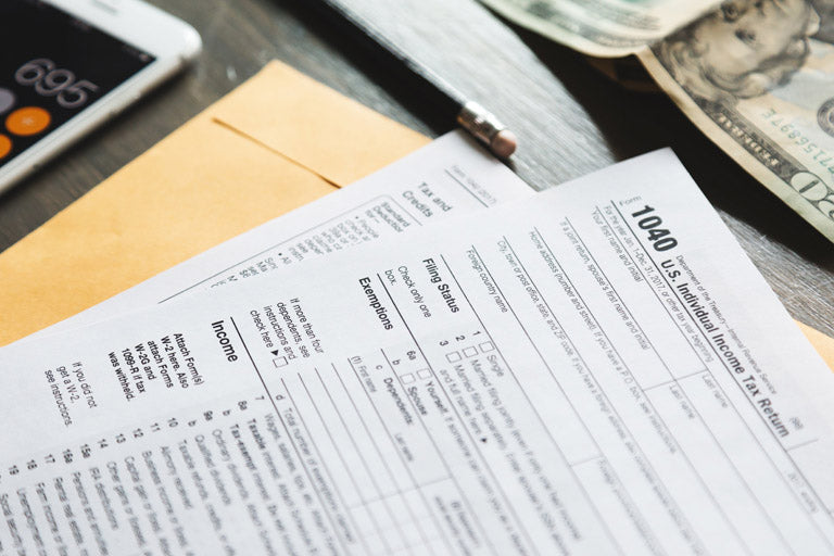 A photo of the 1040 U.S. Individual Income Tax Return form on a desk.