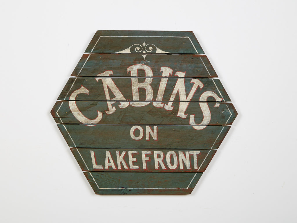 Cabins on Lakefront Hexagonal Sign in Green Americana Art
