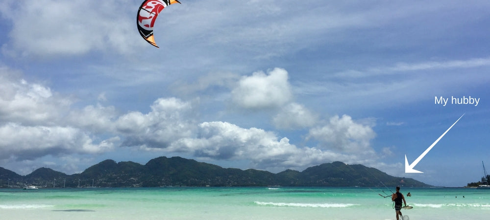 Vacay Founder Elizabeth's husband Seth kite boarding in the Seychelles