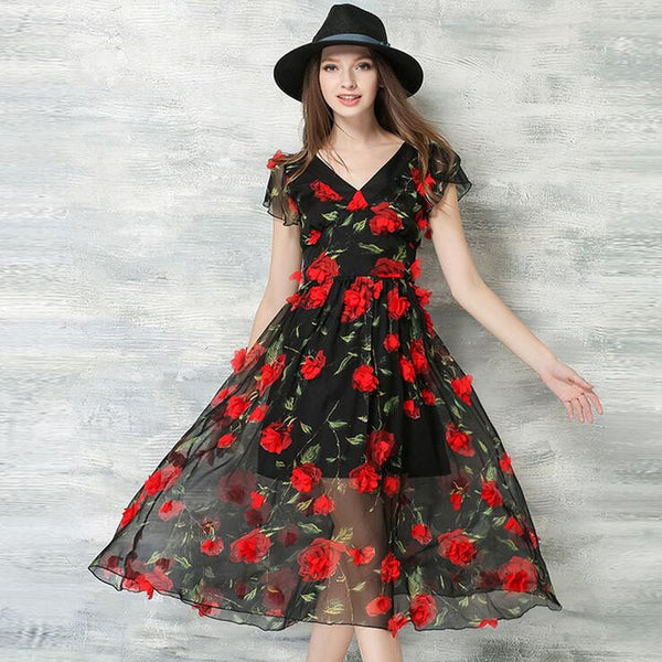Traditional and time tested, a black dress begs for red roses with a small accent of berry drops and leaves. This works well with her red or peach lipstick, and your black-tie tuxedo or black suit.