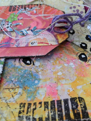 mixed media tag with colorful accents