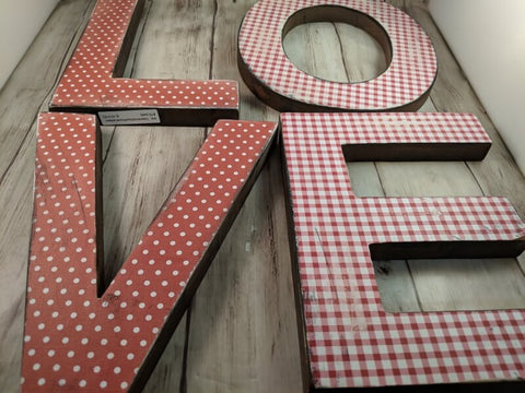 Valentine's Day Red and White Wooden Letters Spelling LOVE