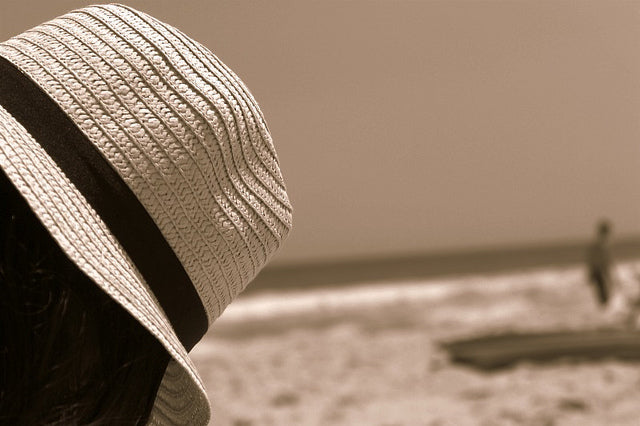 Sun protection for hair includes covering your head with a hat when you're out in the sun.