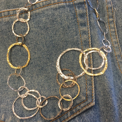 Bold three color silver circle necklace.