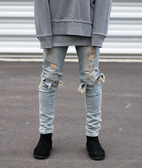 Destroyed Knee Skinny Jeans