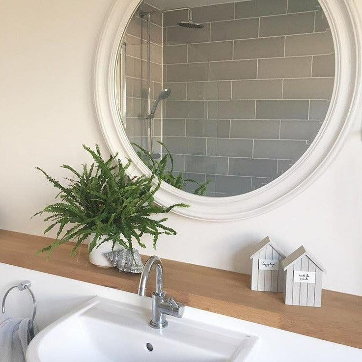 An overall view of this striking contemporary mirror in a typical setting.
