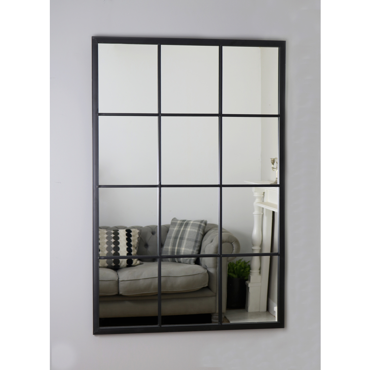 An overall view of this mirror mounted to a wall.