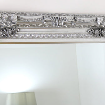 The detailing of this mirrors distinctive frame.