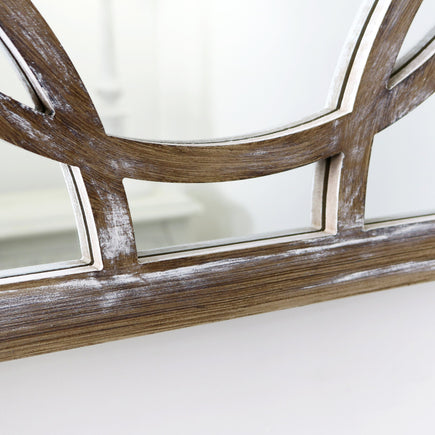 A detail of this mirrors stylish frame.