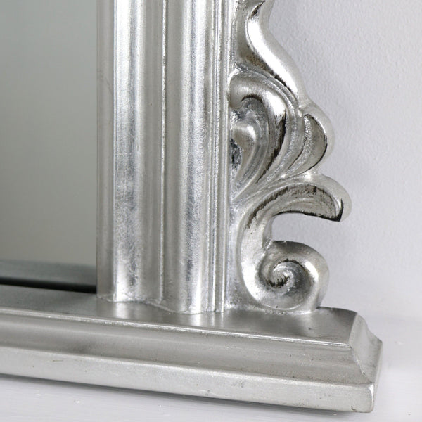 The ornate detailing of this mirrors distinctive border.