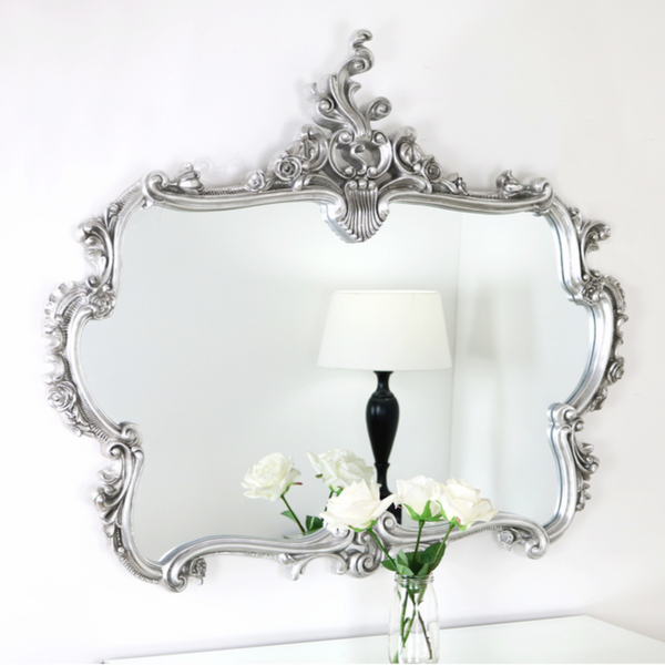 An overall view of this highly decorative, ornate mirror in a typical setting.