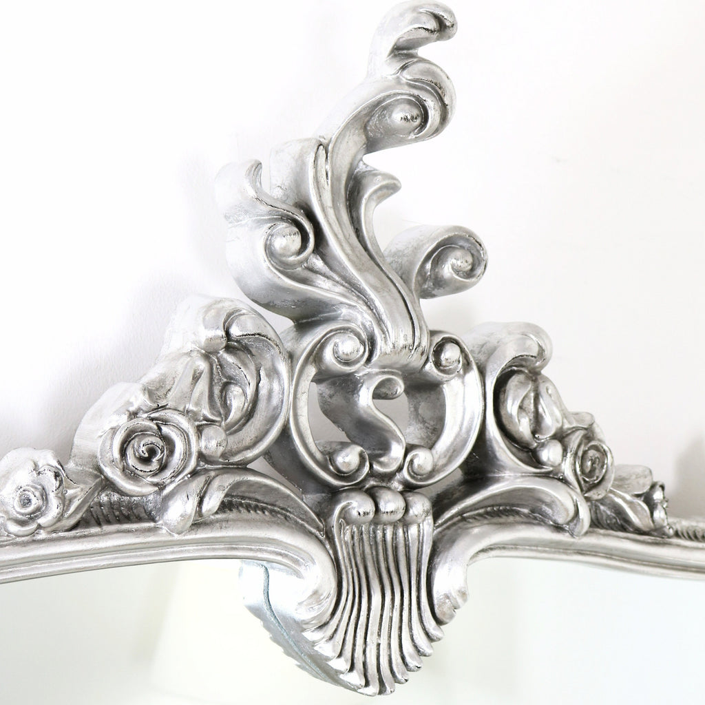 A detail of this mirrors ornate frame moulding.
