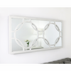 An overall view of this highly decorative mirror in a typical setting.