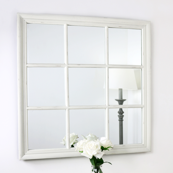 An overall view of this distinctive mirror in a typical setting.