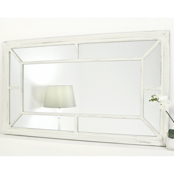 An overall view of this stylish modern mirror in a typical setting.