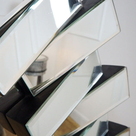 A detail of this mirrors stylish glass border.