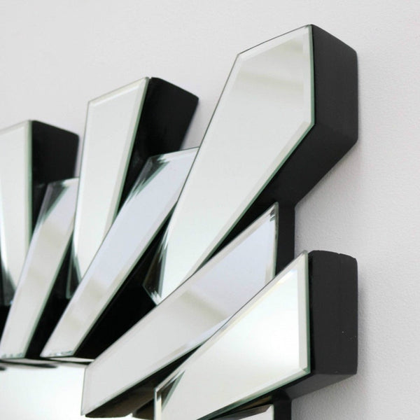 A detail of this mirrors stylish glass frame.