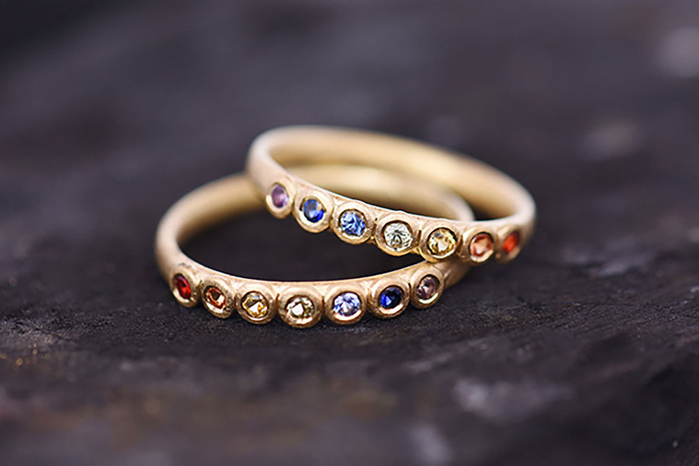 Rainbow sapphire Eternity rings. Made by Goodman Morris.