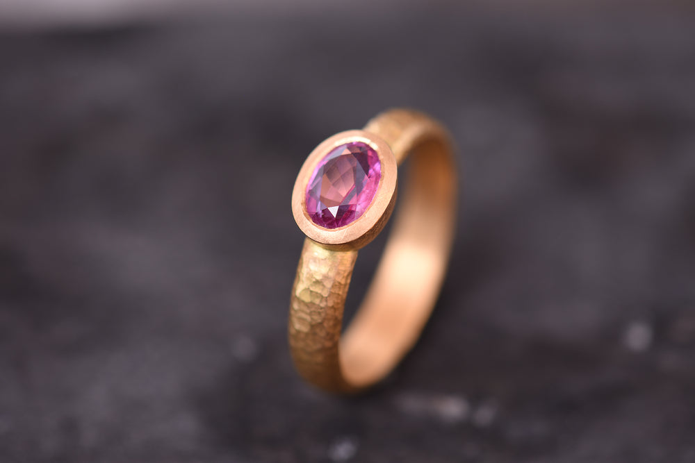 Pink sapphire ring, set in 22ct gold.