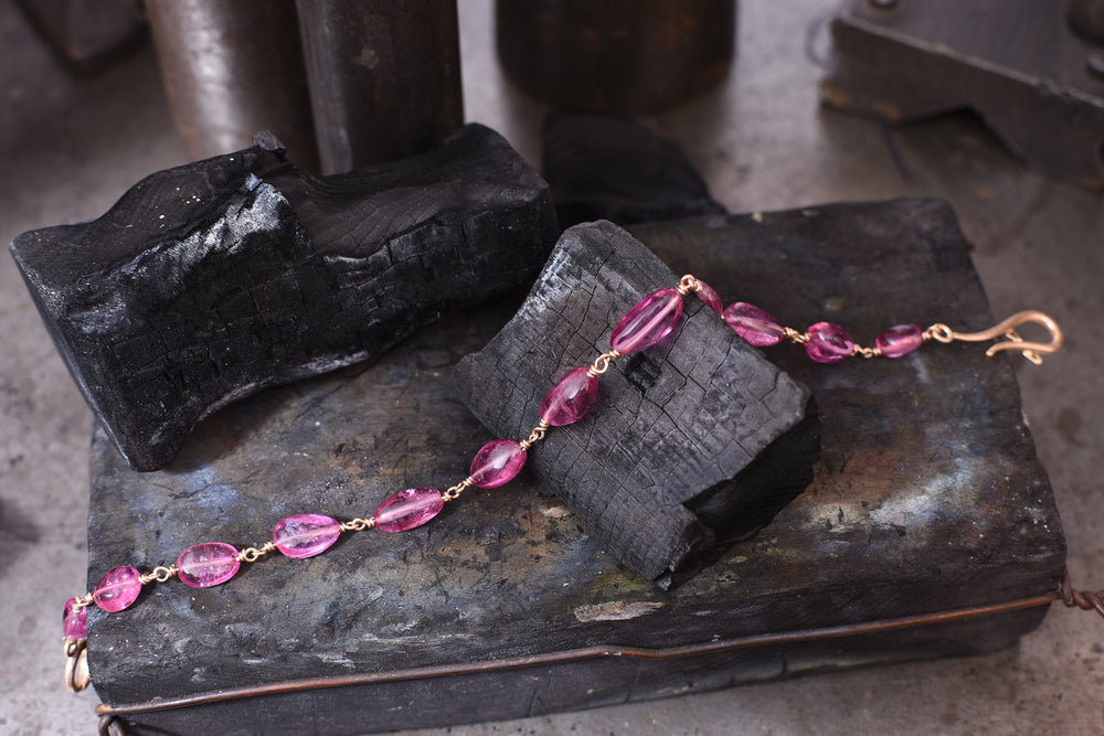 Baby pink tourmaline and 18ct rose gold bracelet.