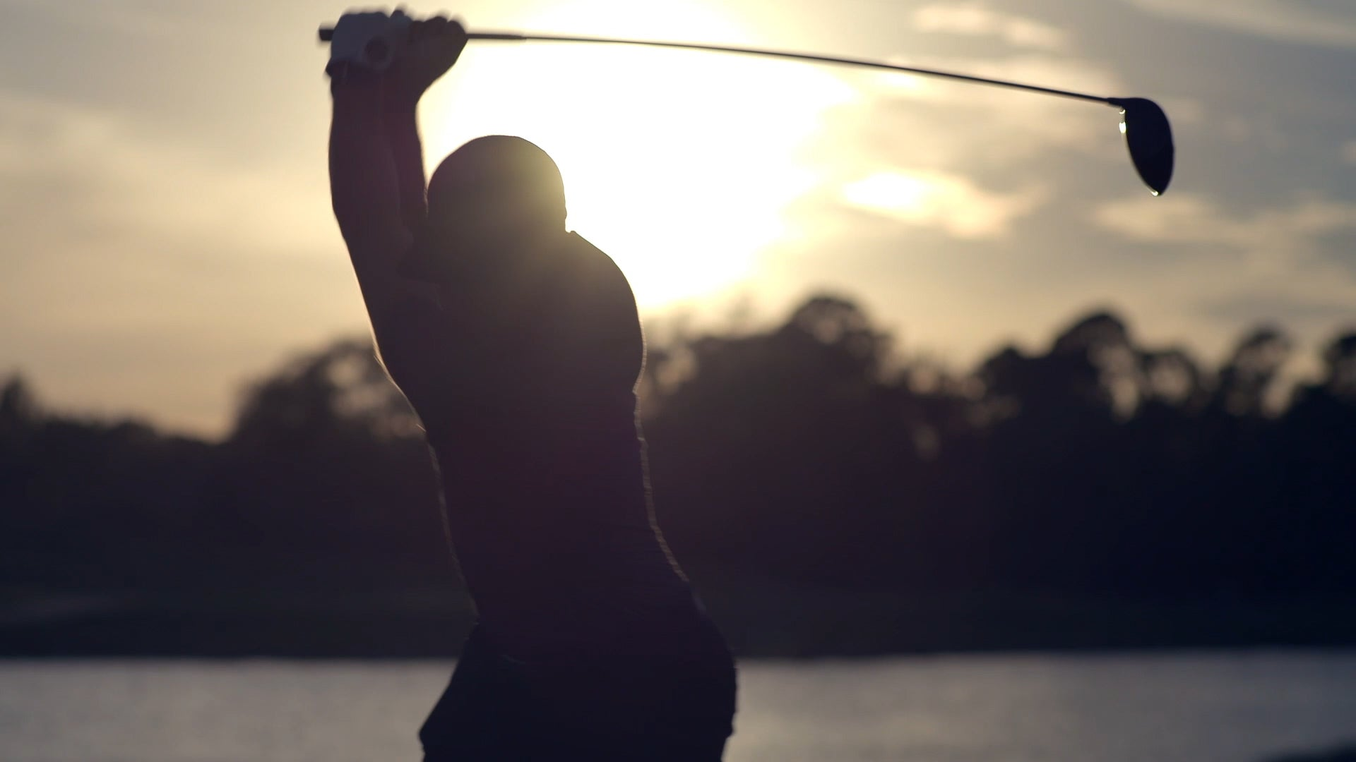 Arccos Golfer swinging in the sunset