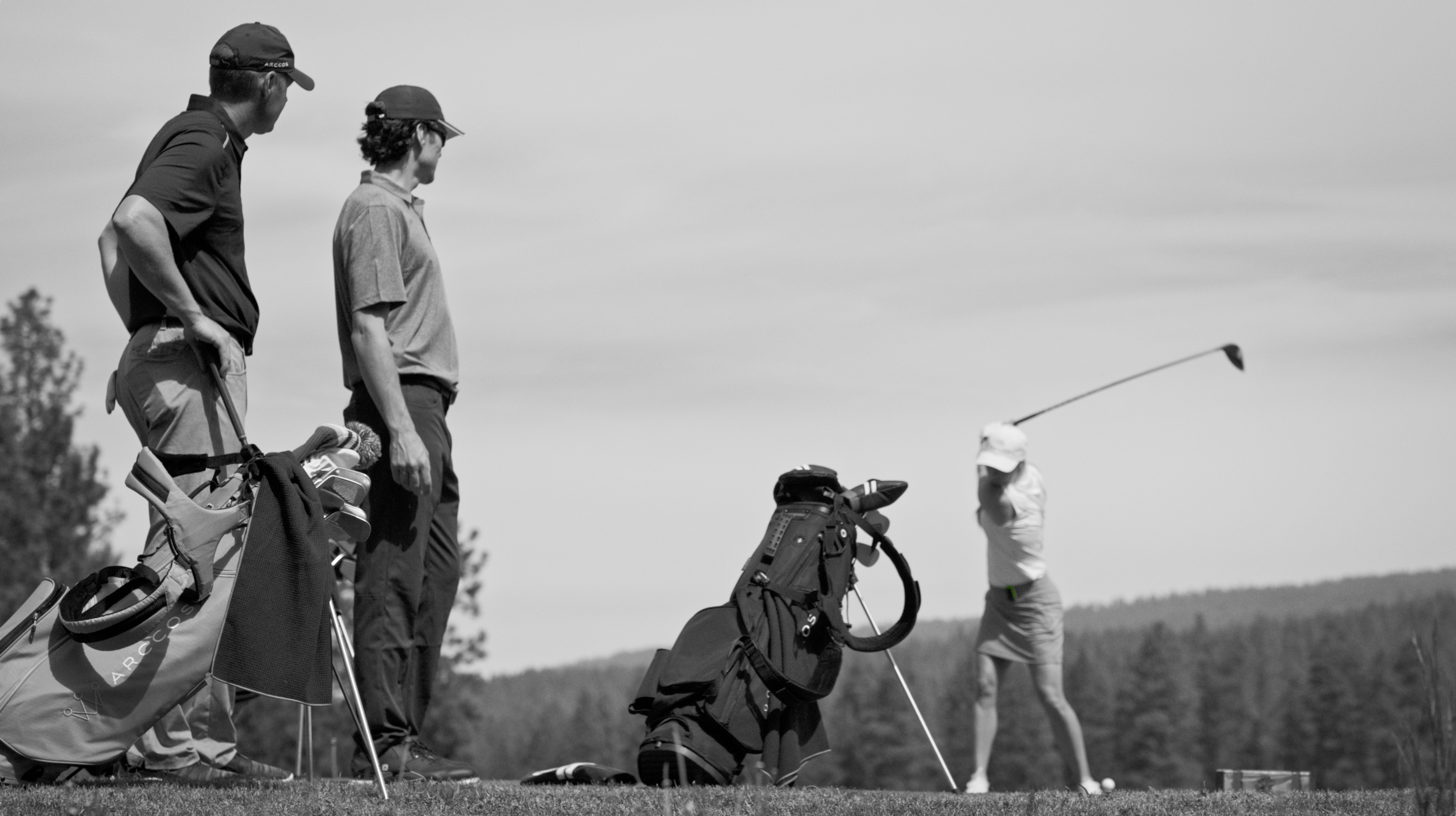 Black & White Image of 3 Golfers