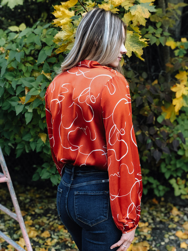 Swirls of Sienna Bodysuit
