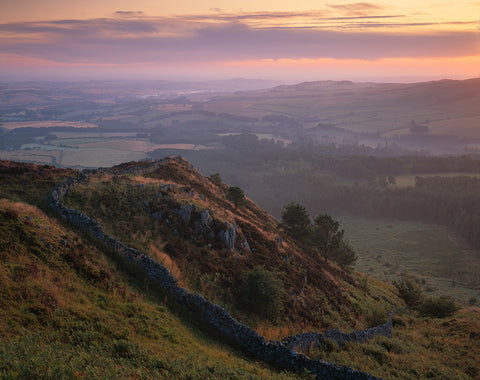 dawn light from rubers law hill in the scottish borders