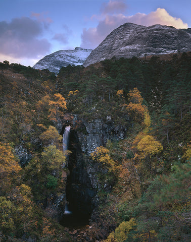 beinn damh mountain in torridon above waterfall with autumn colours colors