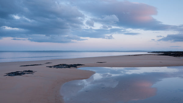 cloud reflected in a tidal pool at Embo Beach Dornoch