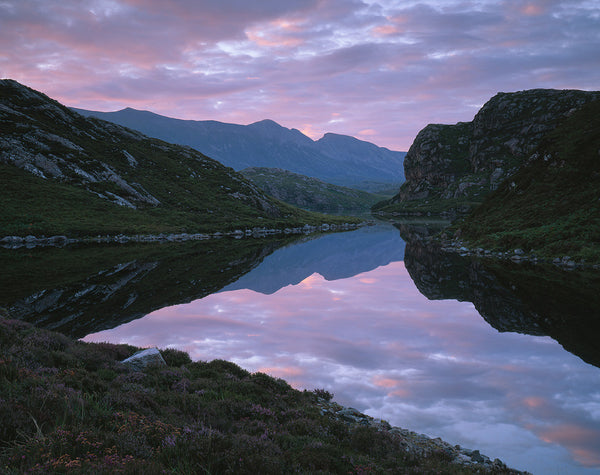Foinaven mountain in Sutherland reflected in water