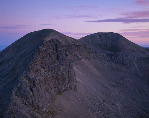 foinaven mountain in sutherland at dawn with pink sky