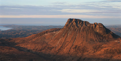 Stac Pollaidh mountain in Inverpolly at sunset