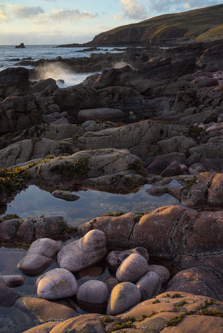Stoer Bay coast in Sutherland at sunset