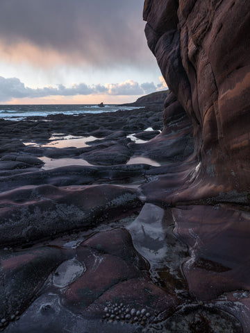 Cliffs and coastline at Stoer Bay in Sutherland at sunset