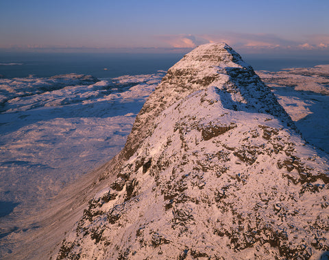 suilven mountain in assynt in winter covered with snow