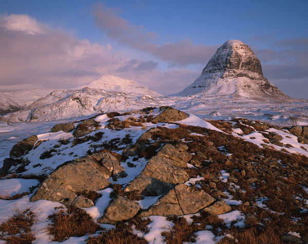 suilven and canisp mountains in assynt in winter covered with snow
