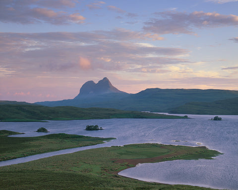 suilven mountain in assynt viewed from cam loch on a summers dawn