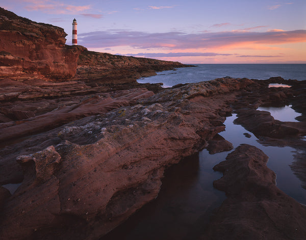 tarbat ness lighthouse at dawn on the easter ross coast