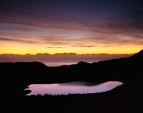 dawn light over the torridon mountains of scotland from the isle of skye