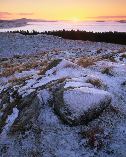 Winter sunset over Rubers Law hill from Peniel Heugh monument Scottish Borders