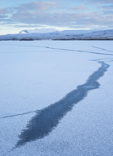 Frozen Loch Meadie in Sutherland looking towards the mountain Ben Loyal in winter