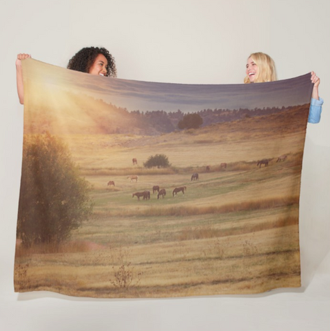 Sunset and Horses Fleece Blanket