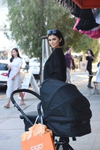 Kylie Jenner pushing baby Stormi in the Nuna pushchair