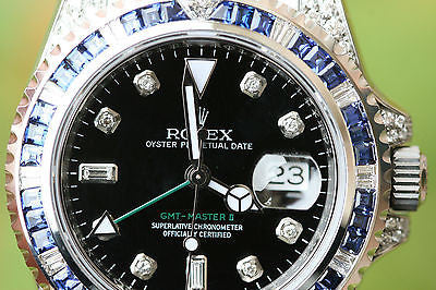 ROLEX GMT MASTER II STAINLESS STEEL 5 CTS. DIAMONDS AND SAPPHIRES BEZEL UNWORN