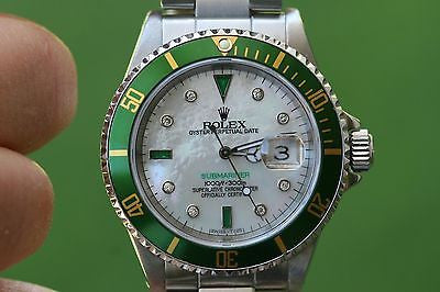 ROLEX MENS SUBMARINER STAINLESS STEEL GREEN BEZEL WHITE MOTHER OF PEARL diamonds
