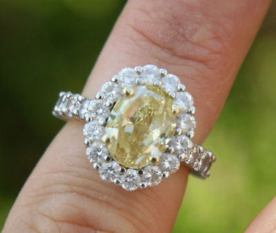 5.37ct Oval Shaped Natural Intense Fancy Yellow Diamond Platinum Ring